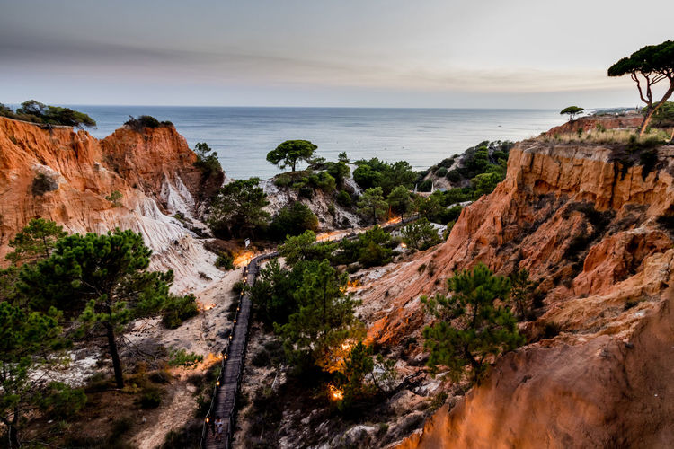 Cliff in the Algarve, Portugal Algarve Algarve Portugal Algarve Coastline Cliffs Orange Rocks Twilight Beach Beauty In Nature Cliff Cliffs And Sea Eroded Formation Horizon Horizon Over Water Land Orange Color Rock Rock - Object Rock Formation Rocky Coastline Scenics - Nature Sea Tranquil Scene Tranquility Water