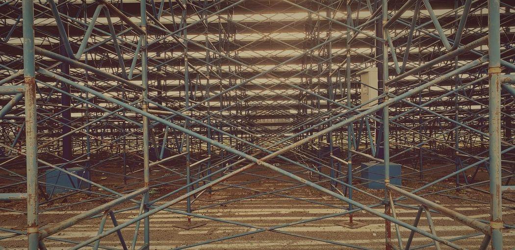 Full frame shot of metallic fence against building