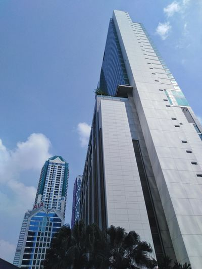office building in bangkok city Bussiness Building High Low Angle View Architecture Office Building Office Metropolis City Citylife Sky Cloud Bangkok Thailand City Modern Business Finance And Industry Sky Architecture Building Exterior Built Structure Tall - High Office Building Tower Tall