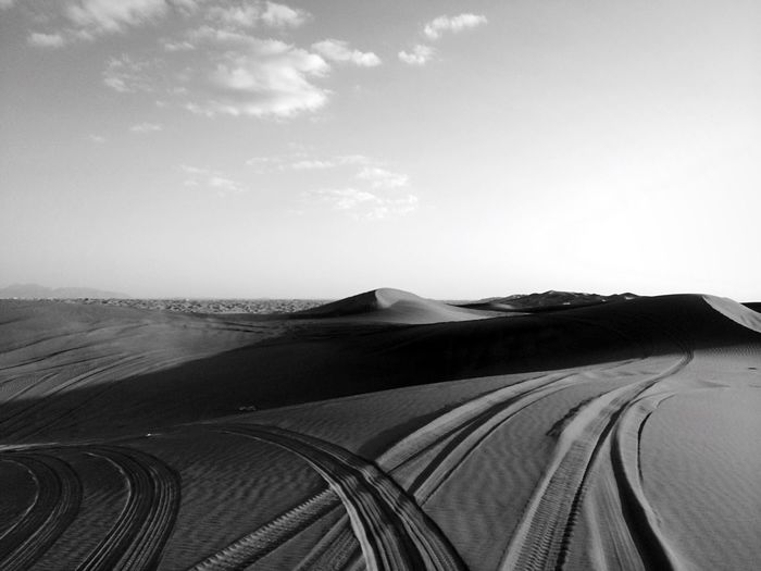 Desert Sand Sand Dune Landscape Nature Scenics Non-urban Scene Day Sky Beauty In Nature No People Outdoors Arid Climate Shushannaagapiphoto Shushannaagapi Iphonephotography Mobilephotography Iphoneonly Shades Of Grey Tire Track Blackandwhite UAE EyeEmNewHere