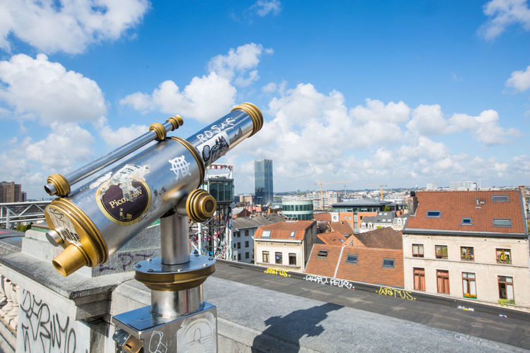 Telescope at the Marolles panoramic lift Belgium Brussel Architecture Binoculars Building Building Exterior Built Structure City Cityscape Cloud - Sky Coin Operated Day Hand-held Telescope History Metal Nature No People Outdoors Residential District Sky Sunlight Telescope The Past