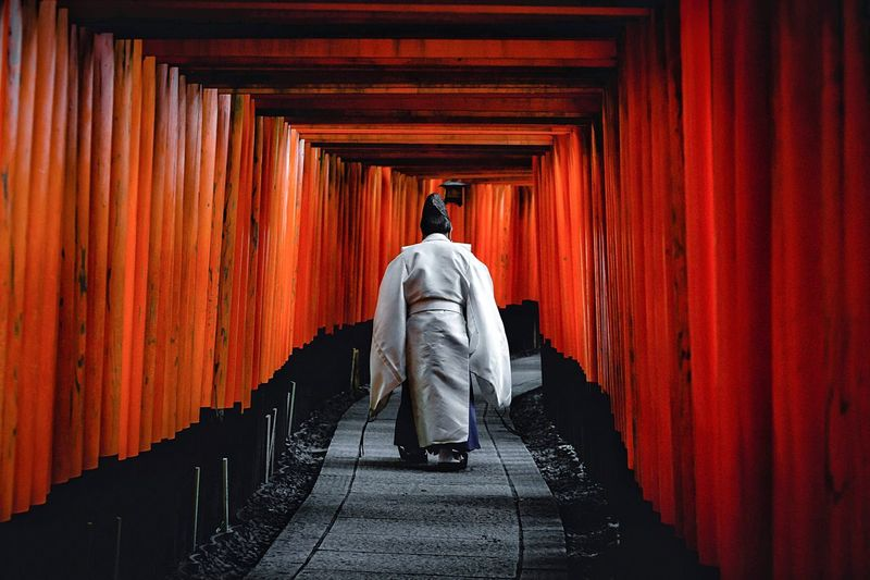 The Prayer Tradition Travel Shrine Kyoto Japan Architecture Rear View Full Length One Person Red Adult Building Indoors  The Way Forward Built Structure Men Direction Walking Real People Religion Standing Unrecognizable Person Corridor Spirituality Hood - Clothing My Best Photo My Best Photo