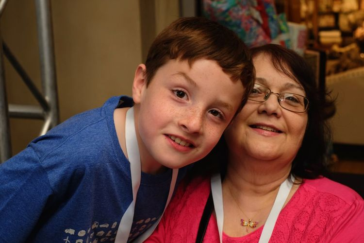 Portrait of grandmother and son at home