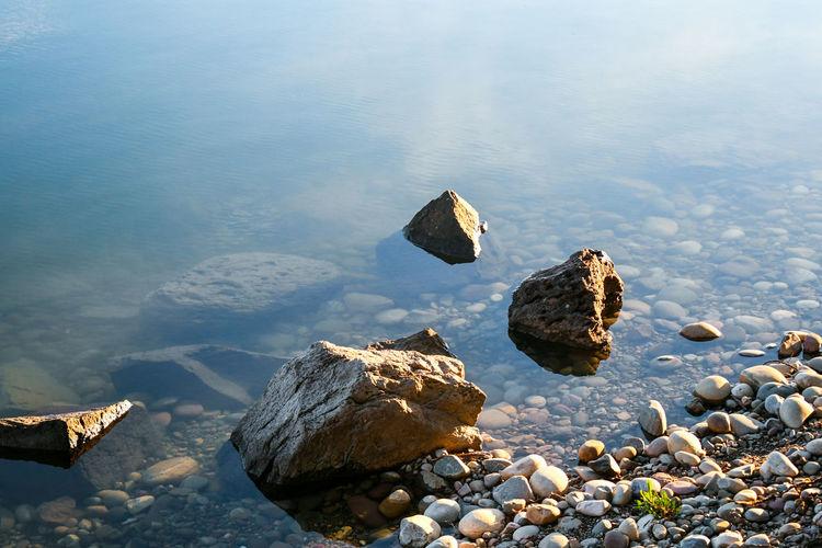 Rocks in calm lake