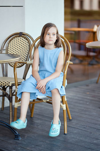 Portrait of a girl sitting on chair