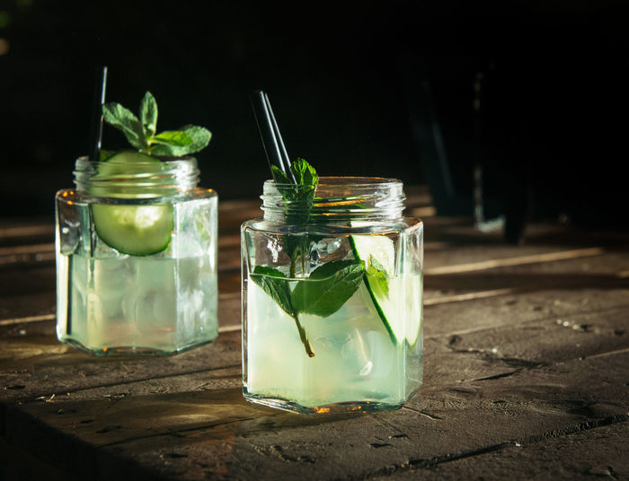 Close-up of drink in glass jar on table