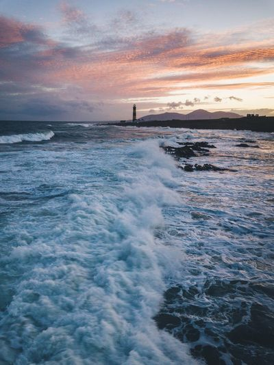 Lighthouse on fire Nature Ireland Northern Ireland Autumn VSCO Water Sea Sky Beauty In Nature Scenics - Nature Sunset Nature Cloud - Sky No People Wave Tranquil Scene Tranquility Horizon Over Water Sport Motion Dusk Waterfront Horizon Beach