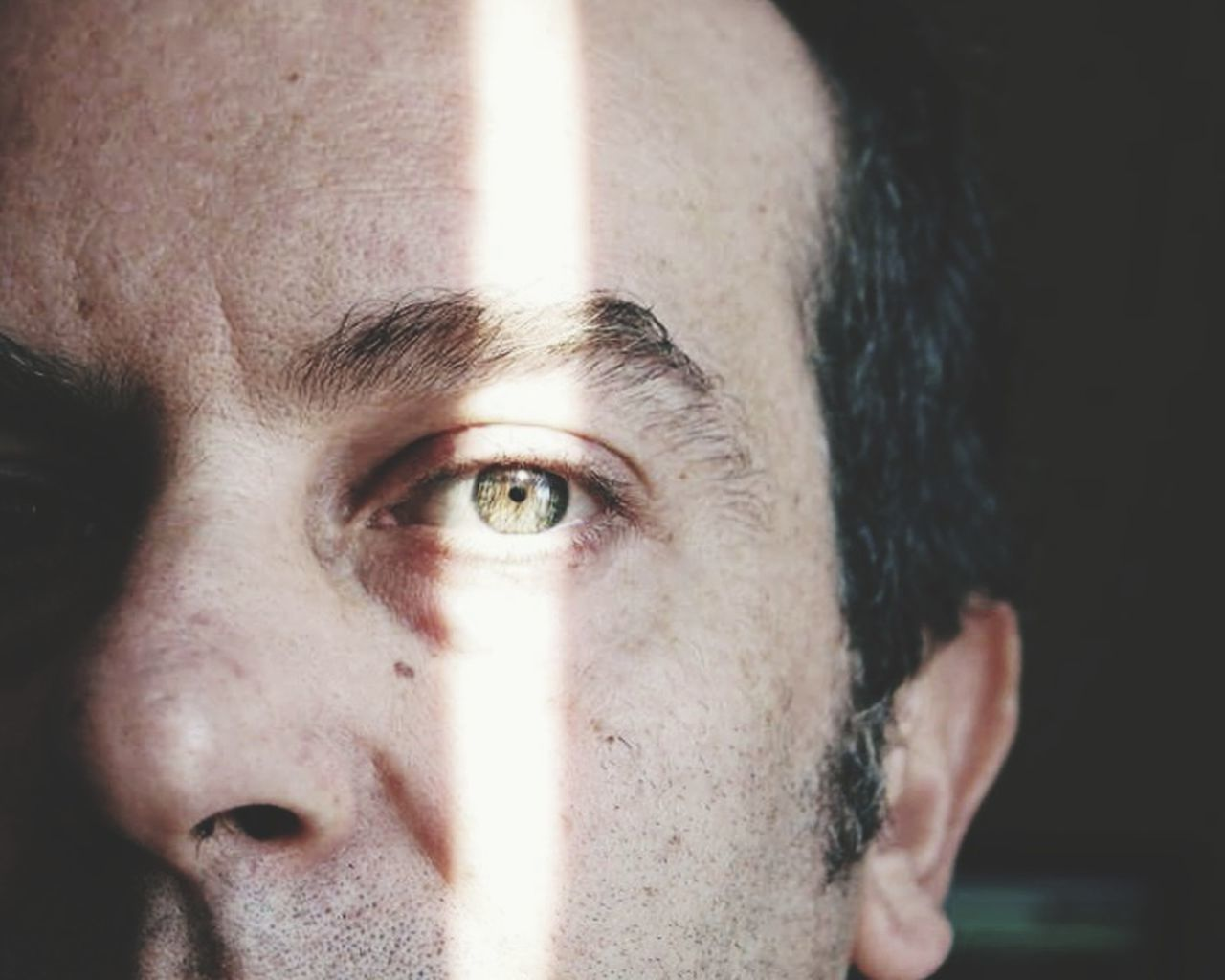 portrait, one person, headshot, close-up, human face, human body part, body part, looking at camera, eye, real people, human eye, young adult, indoors, front view, men, looking, skin, contemplation, eyebrow, black background