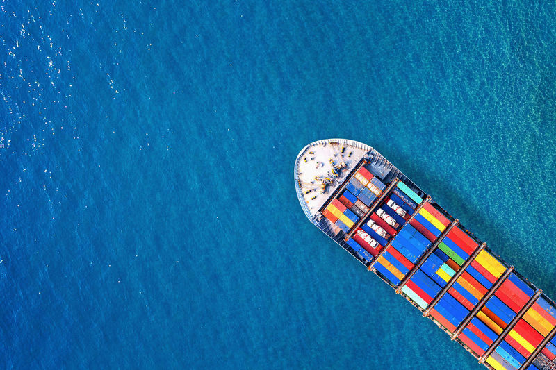 Aerial view of cargo containers in ship on sea