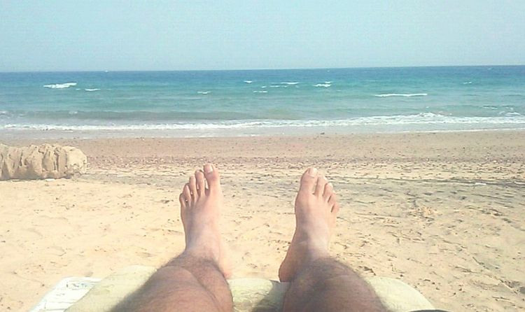 Sea Beach Low Section Barefoot Human Foot Sand Human Body Part Horizon Over Water Human Leg Vacations Relaxation Leisure Activity Water Lifestyles One Person People Real People Day Adults Only Adult
