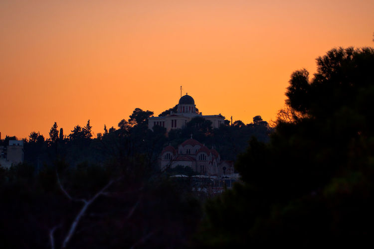 National Observatory of Athens with Church in front. Observatory Architecture Astronomy Building Exterior Built Structure Clear Sky Dome No People Outdoors Place Of Worship Religion Silhouette Sky Spirituality Sunset Travel Destinations Tree