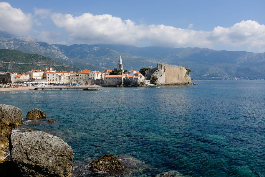 View of Budva town overlooking the sea Budva Adriatic Sea Architecture Beauty In Nature Building Exterior Built Structure Cloud - Sky Coastal Town Day Holiday Destination House Montenegro Mountain Mountain Range Nature No People Outdoors Rock - Object Scenics Sea Sky Tranquility Water