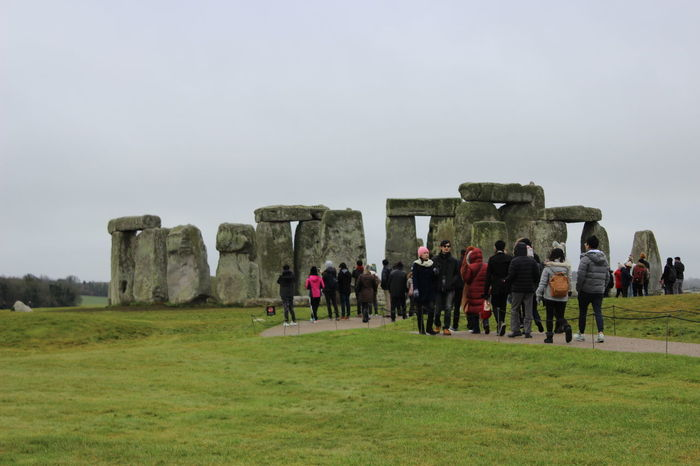 Tourists viewing Stonehenge Stonehenge Memorial Adult Ancient Ancient Civilization Beauty In Nature Day Field Grass History Landscape Large Group Of People Leisure Activity Lifestyles Memorial Men Nature Outdoors People Real People Sky Stonehenge Tourism Travel Destinations Vacations Women
