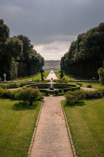 Reggia di Caserta - 2018 23mmf2 FUJIFILM X-T2 Architecture Beauty In Nature Built Structure Cloud - Sky Day Diminishing Perspective Direction Footpath Fujifilm Fujifilm_xseries Fujixseries Garden Path Gardens Grass Green Color Growth Nature No People Outdoors Palace Park Park - Man Made Space Plant Reggia Di Caserta Sky The Way Forward Tree Water Capture Tomorrow My Best Photo