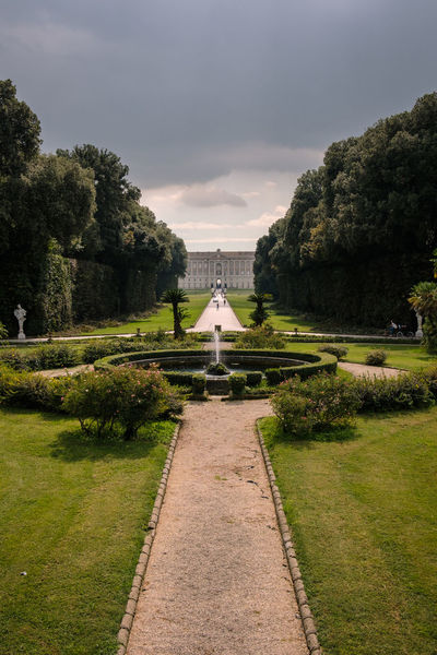 Reggia di Caserta - 2018 23mmf2 FUJIFILM X-T2 Architecture Beauty In Nature Built Structure Cloud - Sky Day Diminishing Perspective Direction Footpath Fujifilm Fujifilm_xseries Fujixseries Garden Path Gardens Grass Green Color Growth Nature No People Outdoors Palace Park Park - Man Made Space Plant Reggia Di Caserta Sky The Way Forward Tree Water