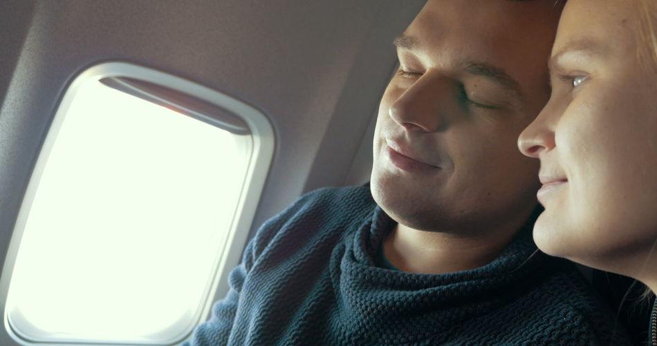 Portrait of man sitting in airplane