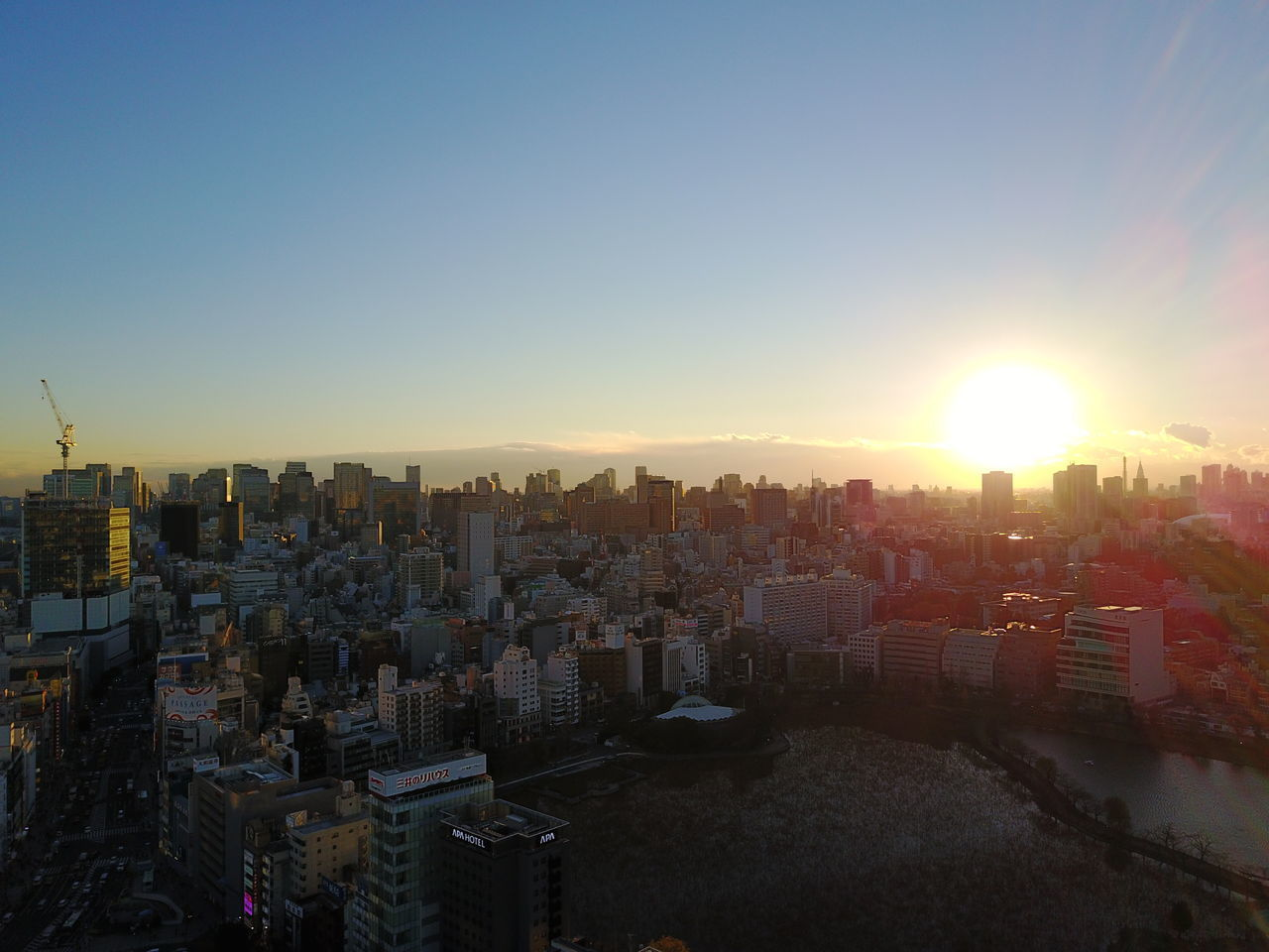 cityscape, city, sunset, architecture, building exterior, sunlight, skyscraper, no people, sun, clear sky, outdoors, built structure, modern, sky, day
