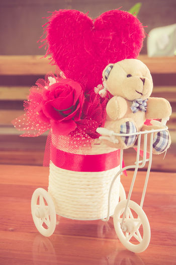 Toy Stuffed Toy Still Life Representation Teddy Bear Indoors  No People Close-up Table Wood - Material Focus On Foreground Art And Craft Creativity Flower Red Flowering Plant Human Representation Softness