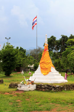 The three pagodas representing the border between Thailand and Myanmar Architecture Border Day Flag Grass International Border Myanmar Nature No People Outdoors Pagoda Patriotism Religion Sculpture Sky Statue Thai Flag Thailand Travel Traveling Tree
