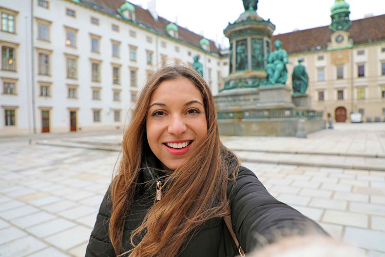 Young woman in Vienna, Austria Portrait Architecture Looking At Camera One Person Smiling Built Structure Front View Building Exterior Real People Lifestyles Young Adult Young Women Hairstyle Hair Young Woman Girl Austria Austria ❤ Wintertime Winter Time Vienna_city Vienna, Austria Vienna Austria Austrianphotographers Woman Portrait