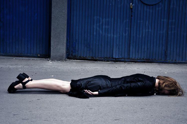 Woman lying down on street