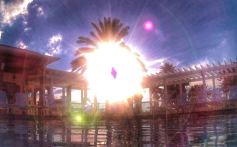 Setting sunbeams are musicial!!! Sun Sunlight Lens Flare Sunbeam Water Bright Sky Travel Destinations Sunny Glowing Cloud - Sky Water Surface Back Lit Rings florida Florida Sky Beautiful Nature