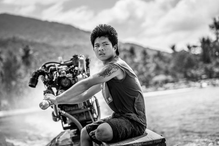 To the Island!! One Person Focus On Foreground Real People Casual Clothing Sitting Day Young Adult Mode Of Transportation Longtail Boat Fast Black & White Wind Boat Speedboat Tattoo Traveling Thailand Clouds Beach Spray Engine Steering Holiday Sea