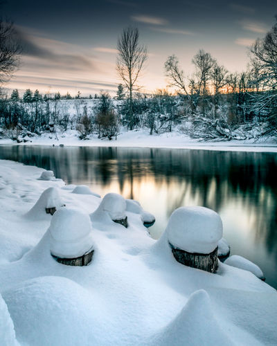 Long exposure taken from a riverbed in Whitefish, Montana. Beauty In Nature Cold Temperature Frozen Ice Ice Skate Lake Landscape Nature Night No People Outdoors Reflection Scenics Sky Snow Sunset Tranquil Scene Tranquility Tree Water Winter