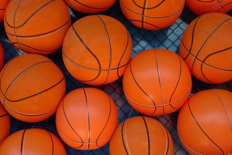 Full frame shot of basketballs on floor