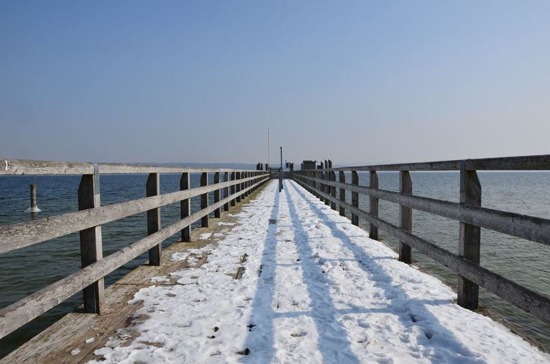 Best EyeEm Shot Winter Beauty In Nature Bestoftheday Built Structure Clear Sky Cold Temperature Copy Space Day Horizon Over Water Jetty Nature No People Outdoors Pier Railing Scenics Sea Sky Tranquil Scene Tranquility Water Winter Wood - Material