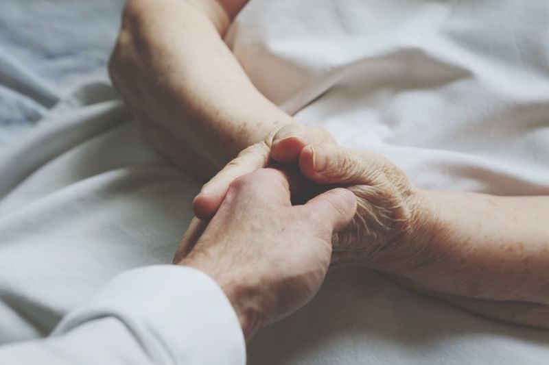 Holding hands of a woman laying in bed Human Body Part Human Hand Two People Togetherness Indoors  High Angle View Real People Women Bonding Men Close-up Day Adult People Care Patient Hospital Adult BYOPaper!