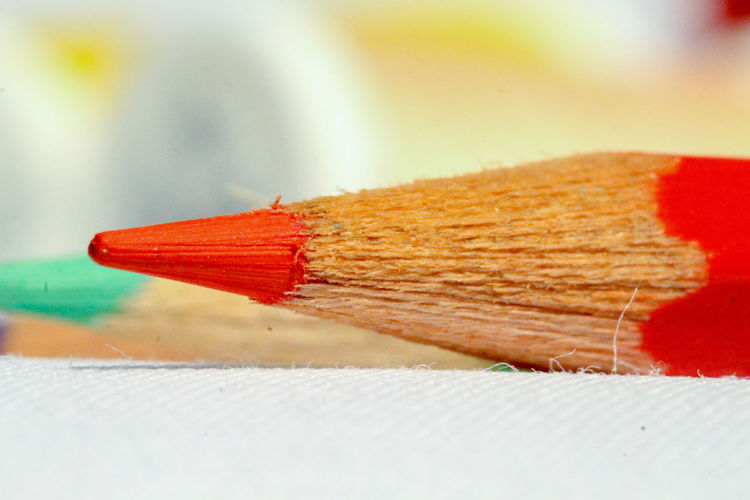 Close-up of colored pencils on wood