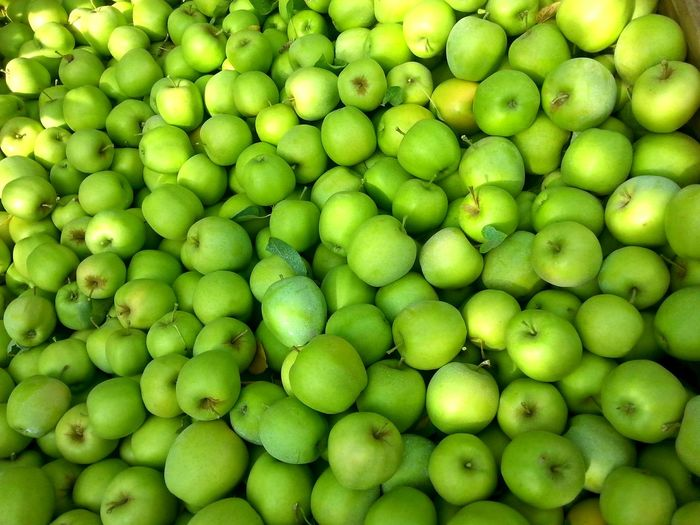 Full frame shot of granny smith apples for sale at market stall