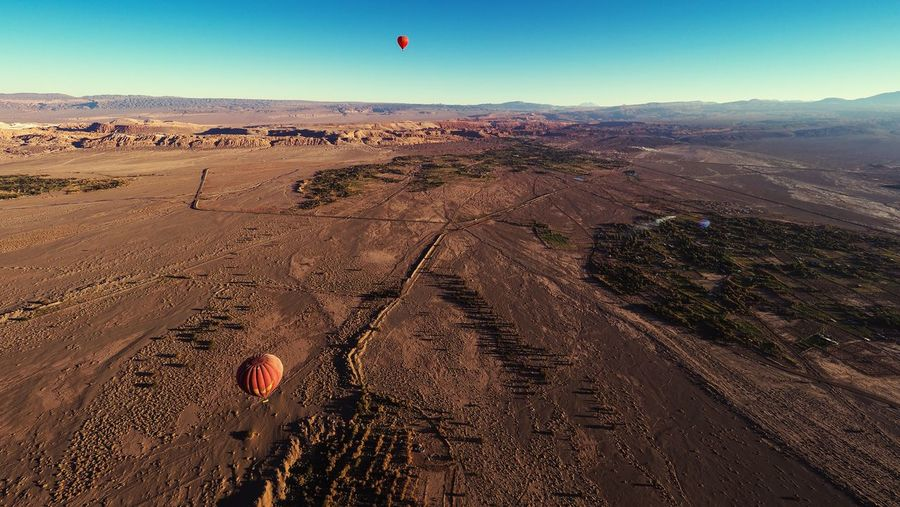 Balloons over San Pedro de Atacama Hot Air Balloon Balloons Adventure Sky Landscape San Pedro De Atacama Atacama Desert Travel Destinations Tourism Tourist Attraction  Adrenaline Chile Balloons Over Atacama Aerial View Outdoors No People Olympus OM-D E-M1 Mark II Arid Climate Clear Sky Desert Landscape Up In The Air Vacations Leisure Activity Agriculture Valle De La Luna Breathing Space Done That. Lost In The Landscape An Eye For Travel Go Higher
