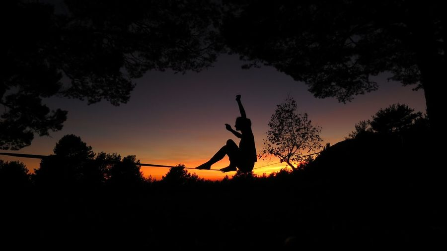 Slackling at sunset in the trees Balancing Act Catalonia Catalunya Orange Sky Sunset Photography Sunset Silhouettes Balance Beauty In Nature Forest Leisure Activity Nature One Person Outdoors People Port Del Compte Real People Scenics Silhouette Sky Slacklife Slackline Slacklining Sport Sunset Tree