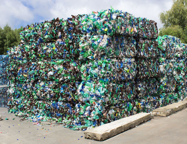 empty plastic bottles for recycling End Plastic Pollution Aluminum Bottles Cloud - Sky Empty Environmental Conservation Industry Large Group Of Objects No People Outdoors Plastic Recycled Materials Recycling Recycling Center Recycling! Stack