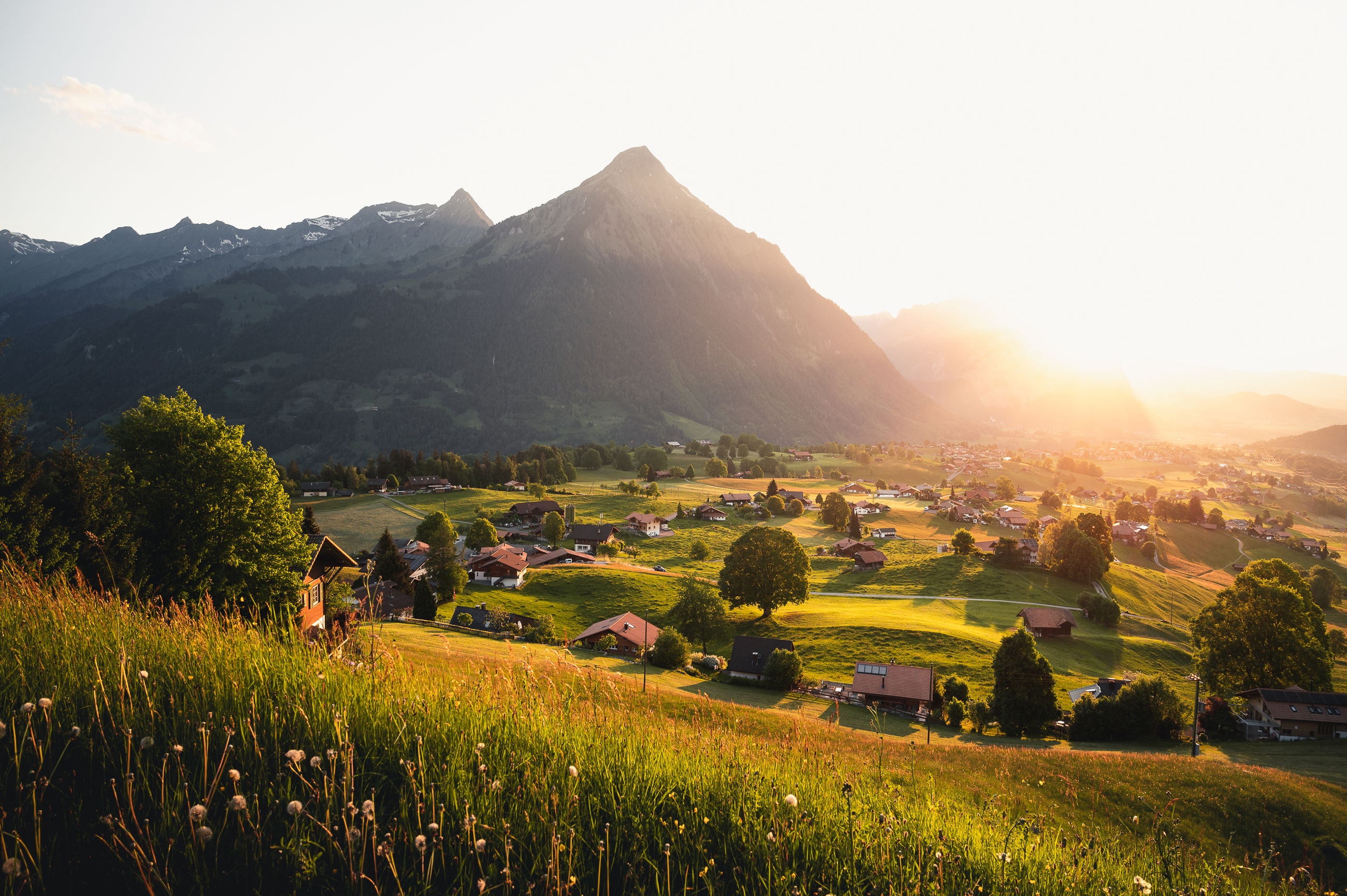 mountain, sky, scenics - nature, plant, landscape, beauty in nature, environment, tree, tranquil scene, field, nature, tranquility, mountain range, land, architecture, growth, grass, built structure, green color, rural scene, outdoors, no people, lens flare