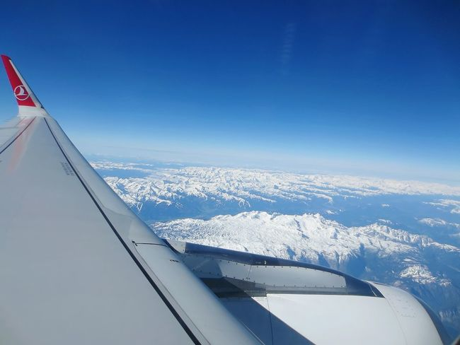 above snowy mountains Outdoors Plane Sky Day No People Aircraft Wing Public Transportation Flying Travel Aerospace Industry Mode Of Transport Air Vehicle Commercial Airplane Transportation Airplane Mountains And Sky Mountain View Snowy Mountains