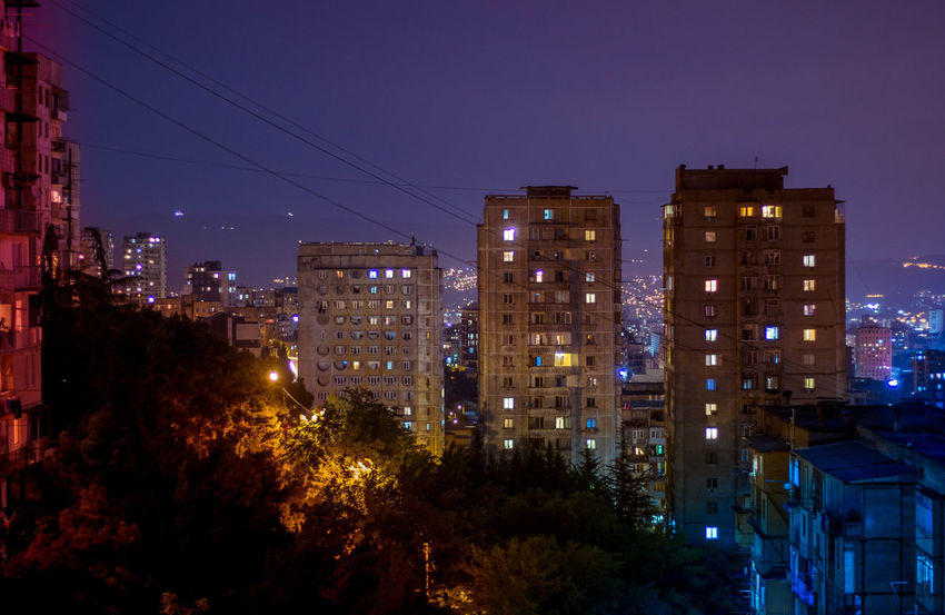Apartment Architecture Building Building Exterior Built Structure City City Life Cityscape Dusk High Angle View Illuminated Lighting Equipment Modern Nature Night Nightlife No People Outdoors Plant Residential District Sky Skyscraper Tree