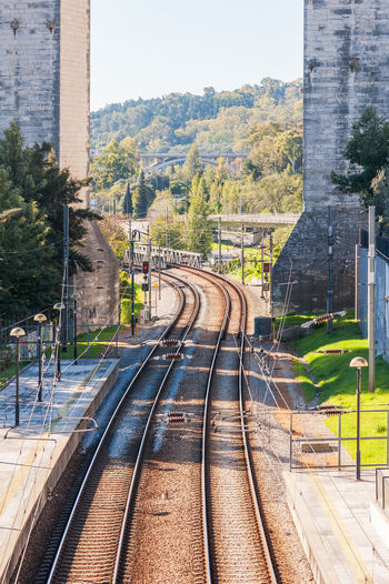 Railways under the Aqueduct of the Free Waters at the Campolide station in Lisbon, Portugal Railways Architecture Built Structure Day No People Outdoors Rail Transportation Railroad Track Railway Railway Road Railway Station Railway Station Platform Railway Track Railway Tracks Sky Transportation Tree
