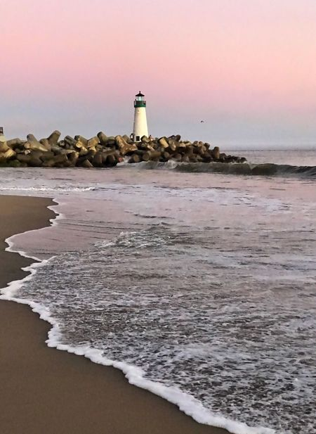 Walden lighthouse st sunset in Santa Cruz CA Sea Lighthouse Beach Water Shore Sand Horizon Over Water Architecture Nature Building Exterior Scenics Built Structure Beauty In Nature Guidance Tranquility Sunset Tranquil Scene Wave No People Outdoors