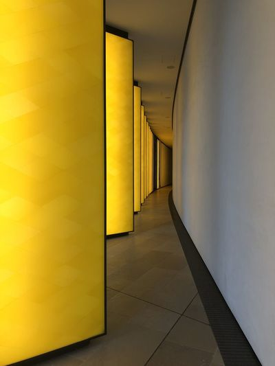 Fondation Louis Vuitton  Architecture Arcade Indoors  Corridor Yellow Building Flooring Built Structure Architectural Column Wall - Building Feature No People Illuminated Empty Tiled Floor The Way Forward Tile Direction Entrance Absence Light Modern Architecture Frank Ghery Building EyeEmNewHere