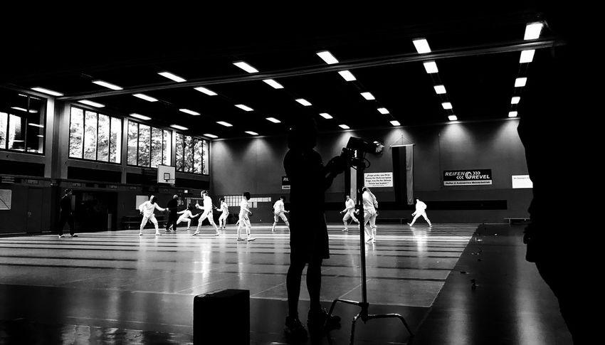 Work Fechten Sport Real People Indoors  Illuminated Lighting Equipment Lifestyles Men Leisure Activity