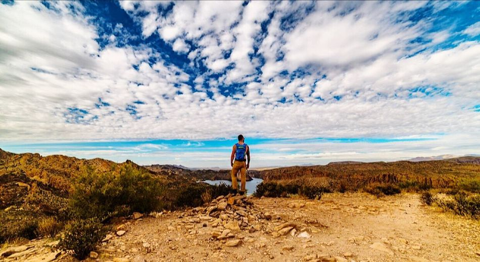 Real People Sky Full Length Cloud - Sky Nature One Person Leisure Activity Lifestyles Beauty In Nature Standing Scenics Tranquility Walking Casual Clothing Rear View Desert Arizona Guidance Hikingadventures Hiking Trail Hike Day Men Sea Adventure