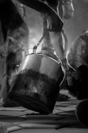 Cropped Hand Serving Tea At Street Market During Night