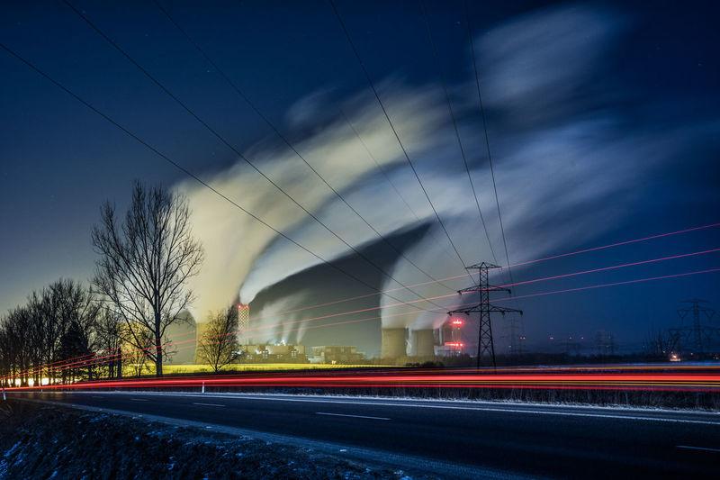 Long exposure of smoke emitting from factory at night