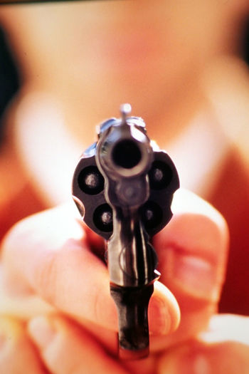 Close-up of person holding a gun