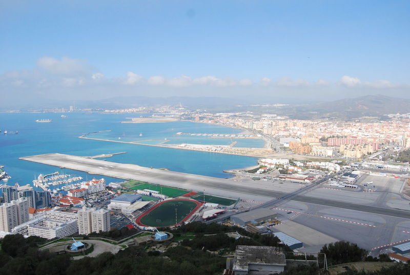 The runway of Gibraltar airport. Gibraltar Landscape Gibraltar Views Gibraltar Airport Gibraltar And Sea Mediterranean  Rock Of Gibraltar Runway Airport Built Structure Cityscape Gibraltar High Angle View Sky Town Water