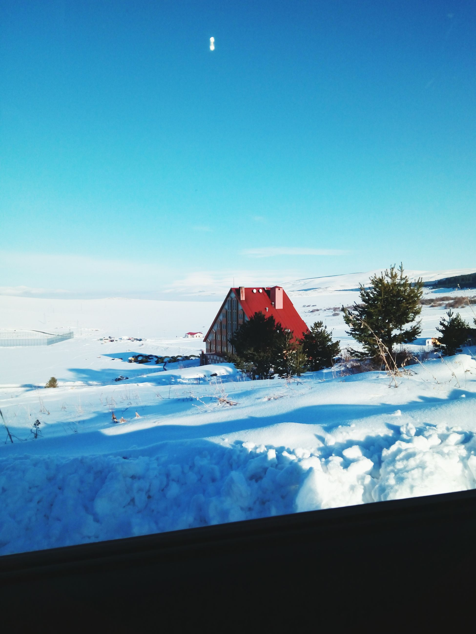 snow, cold temperature, no people, blue, winter, sky, nature, scenics, tranquility, clear sky, outdoors, beauty in nature, building exterior, built structure, day, sea, architecture