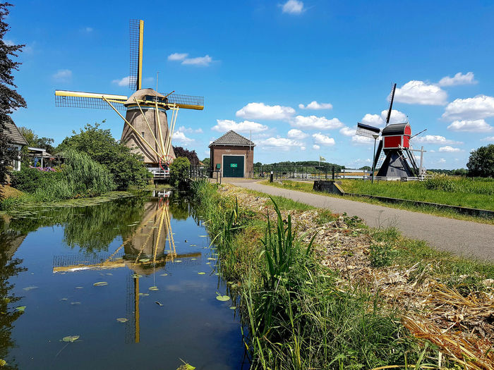 Windmill Windmills Alternative Energy Architecture Building Exterior Built Structure Canal Day Environment Environmental Conservation Fuel And Power Generation Grass Nature No People Outdoors Plant Reflection Renewable Energy Sky Traditional Windmill Turbine Utrecht Water Wind Power Wind Turbine